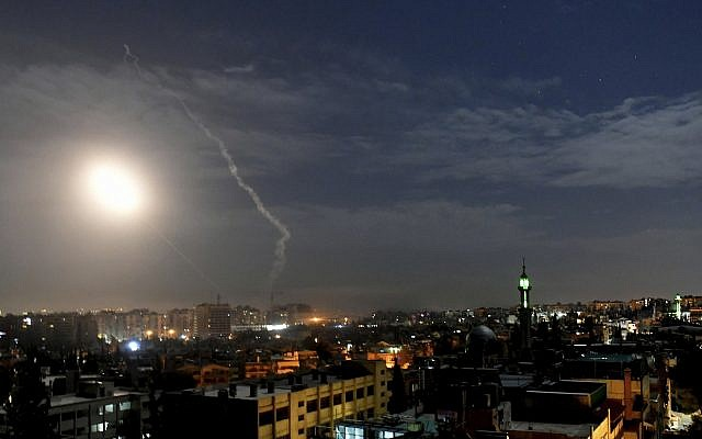 Illustrative. This photo released by the Syrian official news agency SANA, shows missiles flying into the sky near the international airport in Damascus, Syria, January 21, 2019. (SANA via AP)