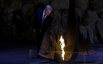 Ukrainian President Petro Poroshenko rekindles the eternal flame in the Hall of Remembrance at the Yad Vashem Holocaust memorial in Jerusalem, January 21, 2019. (AP Photo/Tsafrir Abayov)