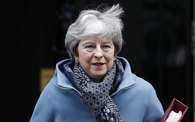 Britain's Prime Minister Theresa May leaves 10 Downing Street for the House of Commons for her weekly Prime Minister's Questions in London, January 23, 2019. (AP Photo/Alastair Grant)