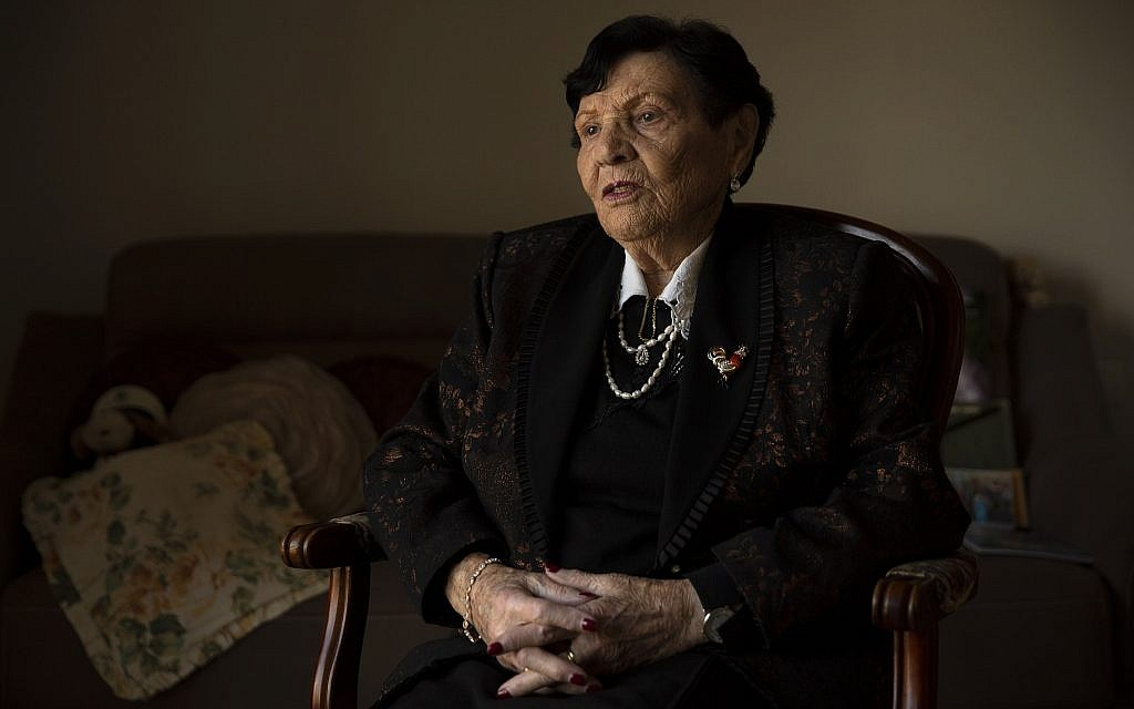 In this, Jan. 23, 2019 photo, Holocaust survivor Cipora Feivlovich speaks to The Associated Press at her house in Jerusalem  (AP Photo/Sebastian Scheiner)