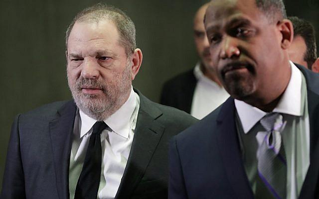 Harvey Weinstein, left, leaves court with attorney Ron Sullivan, Jan. 25, 2019, in New York (AP Photo/Mark Lennihan)