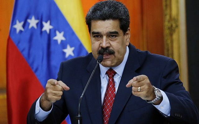 Venezuelan President Nicolas Maduro gives a press conference at Miraflores presidential palace in Caracas, Venezuela, Friday, Jan. 25, 2019, amid a political power struggle between him and an opposition leader who has declared himself interim president. (AP/Ariana Cubillos)
