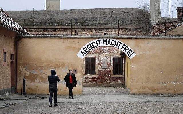 Visitors take photographs at the former Nazi concentration camp in Terezin, Czech Republic, Thursday, Jan. 24, 2019 (AP Photo/Petr David Josek)
