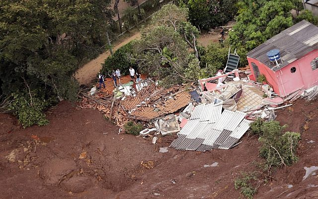 An aerial view shows a destroyed house after a dam collapsed in Brumadinho, Brazil, Saturday, Jan. 26, 2019 (AP Photo/Andre Penner)