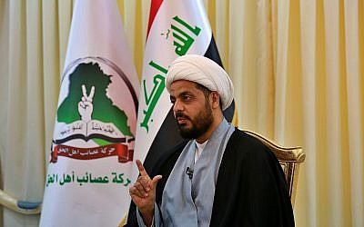 Qais al-Khazali, the leader of the militant Shiite group Asaib Ahl al-Haq, speaks during an interview with The Associated Press, in Baghdad, Iraq. (AP Photo/Khalid Mohammed)