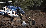 Israeli rescue specialists arrive at a site where a body was found inside a vehicle stuck in the mud, days after a dam collapse in Brumadinho, Brazil, on January 28, 2019. (AP Photo/Leo Correa)