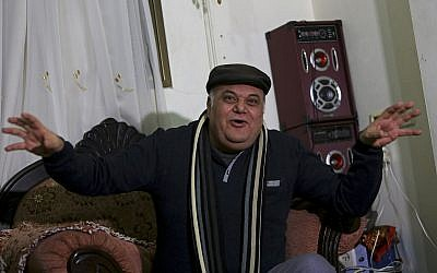 Palestinian actor and playwright Ali Abu Yaseen, 55, gives an interview in his home at the Shati refugee camp in Gaza City on Tuesday. (AP Photo/Adel Hana)