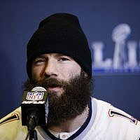 New England Patriots' Julian Edelman speaks with members of the media during a news conference Wednesday, Jan. 30, 2019, ahead of the NFL Super Bowl 53 football game against Los Angeles Rams in Atlanta. (AP Photo/Matt Rourke)