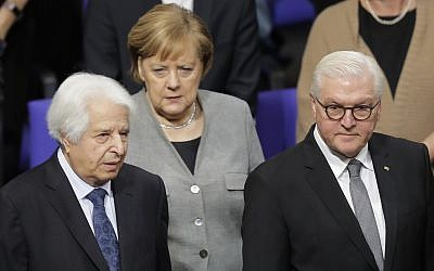 From left, Israeli Historian Saul Friedlander, German Chancellor Angela Merkel and German President Frank-Walter Steinmeier arrive for a remembrance event of the parliament Bundestag to commemorate the victims of the Holocaust at the Reichstag building in Berlin, January 31, 2019. (AP Photo/Markus Schreiber)