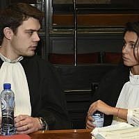 Matthieu Danloy, left, and Aurelia Psalti, lawyers of the family of victims Emmanuel and Miriam Riva, talk before the start of the trial of Mehdi Nemmouche at the Justice Palace in Brussels, on January 31, 2019. (John Thys, Pool Photo via AP)