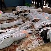 """This image posted online by the Shaam News Network, a loosely organized group opposed to Bashar Assad, on Sunday, Aug. 16, 2015, which has been verified and is consistent with other AP reporting, shows the bodies of people killed in Syrian government airstrikes in Douma, a suburb of Damascus, Syria. The United Nations humanitarian chief said he is """"horrified"""" by the attacks on civilians taking place in Syria, singling out in particular government airstrikes the previous day that killed nearly 100 people in a Damascus suburb. (Shaam News Network via AP video)"""