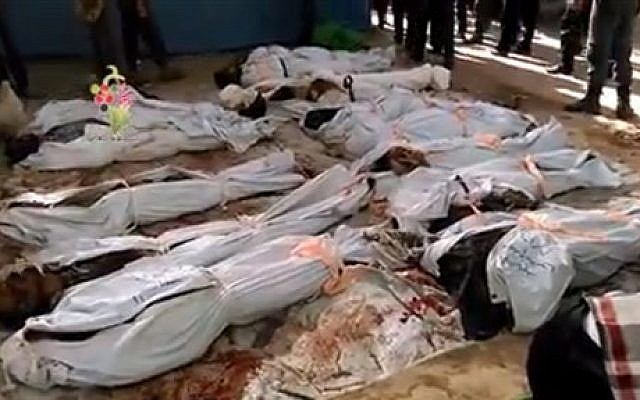 "This image posted online by the Shaam News Network, a loosely organized group opposed to Bashar Assad, on Sunday, Aug. 16, 2015, which has been verified and is consistent with other AP reporting, shows the bodies of people killed in Syrian government airstrikes in Douma, a suburb of Damascus, Syria. The United Nations humanitarian chief said he is ""horrified"" by the attacks on civilians taking place in Syria, singling out in particular government airstrikes the previous day that killed nearly 100 people in a Damascus suburb. (Shaam News Network via AP video)"