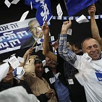 In this March 17, 2015 file photo, Israeli Prime Minister Benjamin Netanyahu's Likud party supporters react to exit poll results at the party's election headquarters In Tel Aviv.  (AP Photo/Oded Balilty)