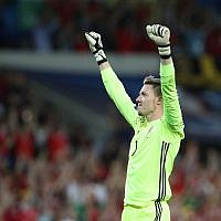 Wales goalkeeper Wayne Hennessey celebrates after the Euro 2016 Group B soccer match between Russia and Wales at the Stadium municipal in Toulouse, France, Monday, June 20, 2016. (AP Photo/Thanassis Stavrakis)