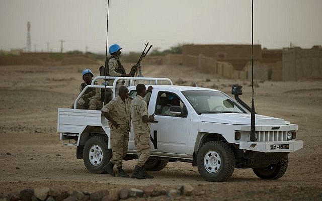 In this July 28, 2013 photo, United Nations peacekeepers stand guard at a polling station, during presidential elections in Kidal, Mali. (AP/Rebecca Blackwell)