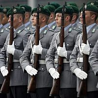 German soldiers stand guard for a military welcome ceremony of then-Defense Minister Thomas de Maiziere for his counterpart from Afghanistan, Bismillah Khan Mohammadi, at the defense ministry in Berlin, Germany on Oct. 24, 2013. (AP Photo/Michael Sohn)