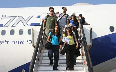 Illustrative: New immigrants to Israel stepping off the plane at Ben Gurion Airport. (Courtesy Nefesh B'Nefesh/via JTA)