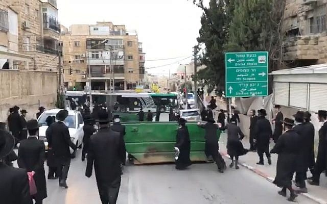 Screen capture from video of ultra-Orthodox demonstrators protesting in Jerusalem against the planned autopsy of a baby, January 2, 2019. (YouTube)