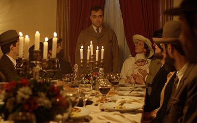 Portuguese army captain Arthur Carlos de Barros Basto (Rodrigo Santos) presides at the head of the table with his wife Lea and child in a scene from the new historical drama 'Sefarad.' (Courtesy Miami Jewish Film Festival)