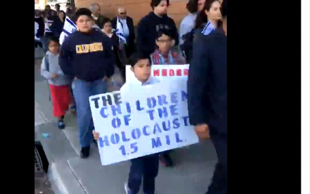 Members of Church of Jesus Christ Temple Philadelphia in Salinas California march on January 27, 2019 to mark International Holocaust Memorial Day (Screencapture/Twitter)