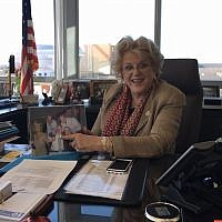 Carolyn Goodman, the mayor of Las Vegas, poses with a photo of her family in her office, Feb. 10, 2016. (Ron Kampeas/JTA)