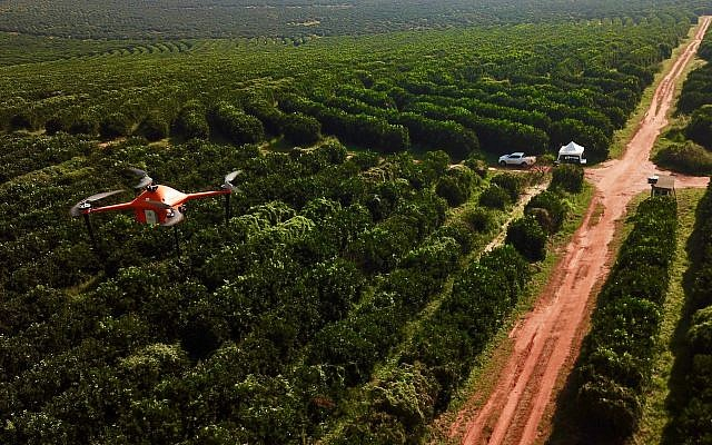 A SeeTree drone flying over fields (Courtesy)