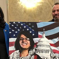 Michigan Democrat Rashida Tlaib poses with the pro-Hezbollah, pro-Hamas 'right of return' activist Abbas Hamideh on Saturday, January 12, 2019. (Twitter)
