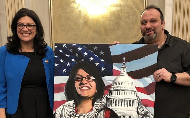 "Michigan Democrat Rashida Tlaib poses with the pro-Hezbollah ""right of return"" activist Abbas Hamideh on Saturday, January 12, 2019. (Twitter)"