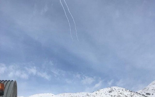 Trails left by the Iron Dome air defense system intercepting a Syrian projectile over Mount Hermon in the Golan Heights, on January 20, 2019. (Israel Defense Forces)