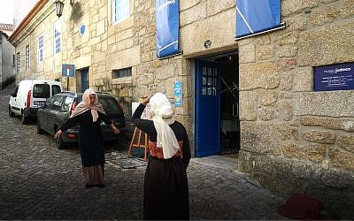 Actors re-enact scenes from the Inquisition period outside Belmonte's Jewish museum, October 14, 2018. (Cnaan Liphshiz)