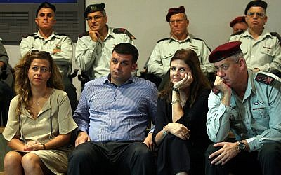 Then chief of staff Benny Gantz sits with members of the Rabin family at a seminar at the Yitzhak Rabin Center in October 2012 marking the anniversary of prime minister Yitzhak Rabin's assassination. (Roni Schutzer/Flash90)