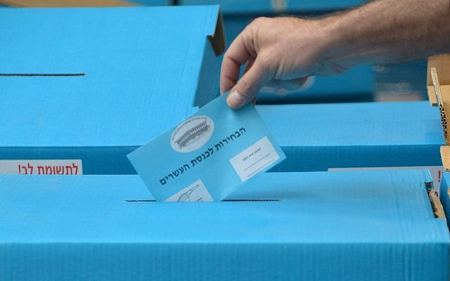 Illustrative: Workers pack ballot boxes ahead of the Knesset elections on February 25, 2015. (Flash90)