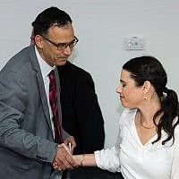 Newly appointed Justice MinisterAyelet Shaked (R) shakes hands with State Prosecutor Shai Nitzan during a ceremony at the Justice Ministry in Jerusalem on May 17, 2015. (Dudi Vaknin/pool)