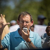 Joint (Arab) List MK Dov Khenin attends a protest of Ethiopians from the Absorption Center in Mevaseret Zion near the Knesset in Jerusalem on June 26, 2017. (Yonatan Sindel/Flash90)