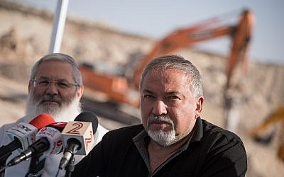 Then-defense minister Avigdor Liberman visits the site of the new West Bank settlement of Amichai, built for residents of the demolished Amona outpost, on October 18, 2017. (Hadas Parush/Flash90)