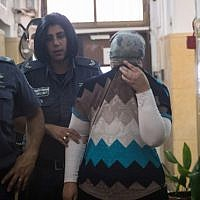 An ultra-Orthodox woman is brought to a Jerusalem court on July 29, 2018, under charges of abusing her children by injecting them with insulin (Yonatan Sindel/Flash90)