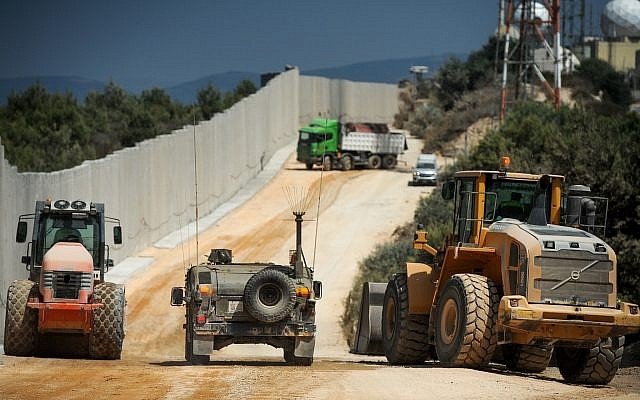 Construction work takes place near a new concrete wall on the border between Israel and Lebanon, near Rosh Hanikra in Northern Israel, on September 5, 2018. (Basel Awidat/Flash90)