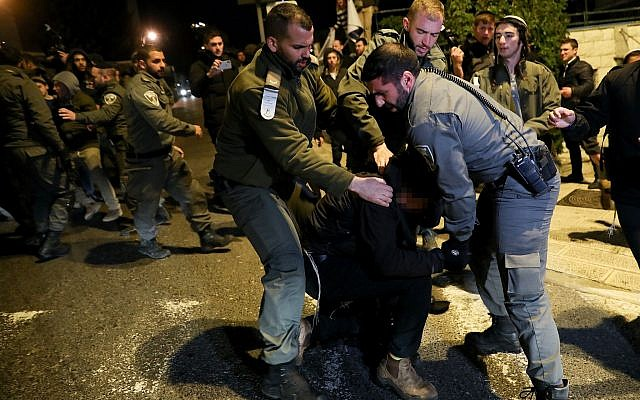 Police arrest a man during a protest outside the Prime Minister's Residence in Jerusalem, in support of the Jewish youth suspects in a major security probe whose details are under gag order, January 5, 2019 (Noam Revkin Fenton/Flash90)