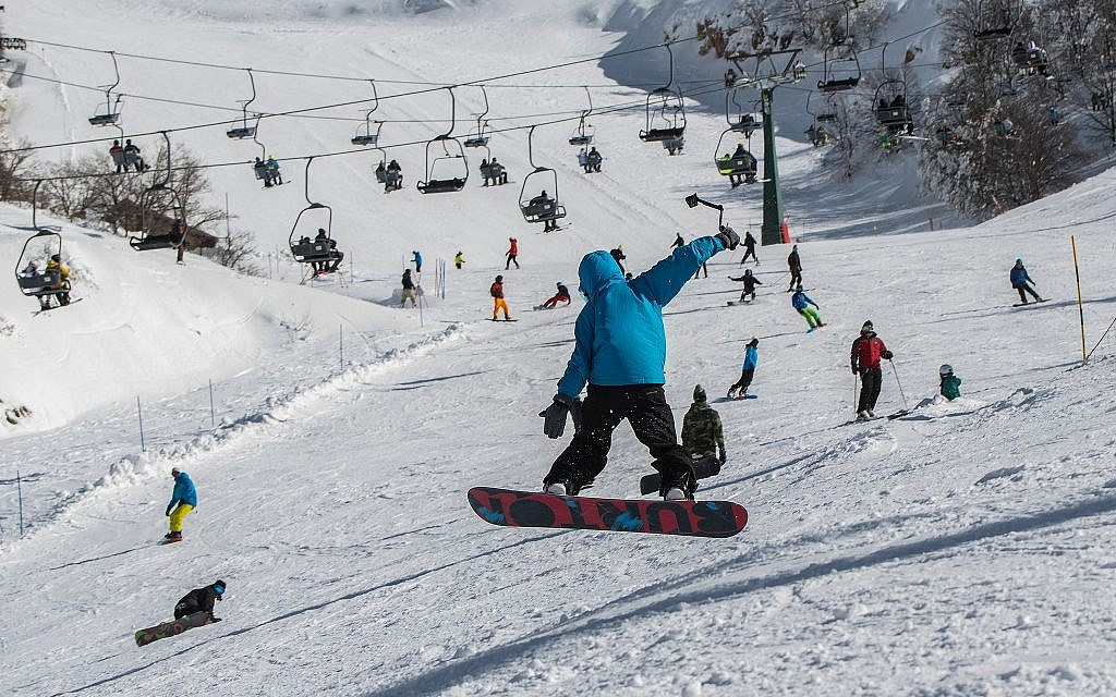 Israelis ski and snowboard on Mount Hermon on January 11, 2019. (Basel Awidat/Flash90)