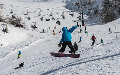Israelis ski and snowboard on Mount Hermon on January 11, 2019. (Basel Awidat/Flash90)