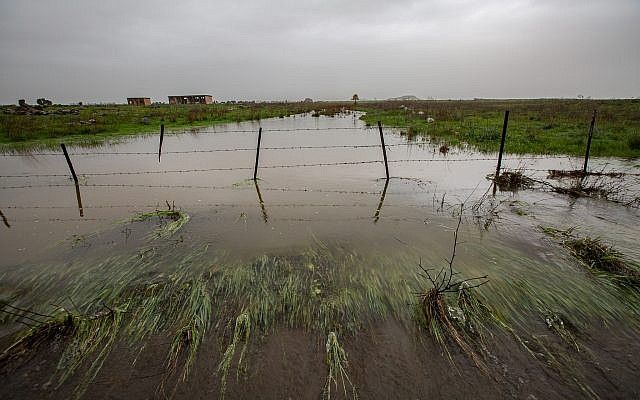 A stream overflows after rains on the Golan Heights, January 14, 2019. (Maor Kinsbursky/Flash90)