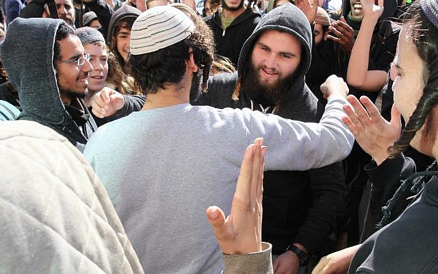 A suspect in the killing of Aisha Rabi is embraced by a supporter outside the Rishon Lezion Magistrate's Court after being released to house arrest on January 10, 2019. (Flash90)