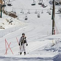 An Israeli soldier skis in the snow covered Mount Hermon in the Golan Heights, northern Israel, on January 21, 2019. The ski site was closed to visitors for the day, after a rocket fired from Syria headed to the area was intercepted on January 20 by Israel's Iron Dome defense system (Basel Awidat/Flash90)