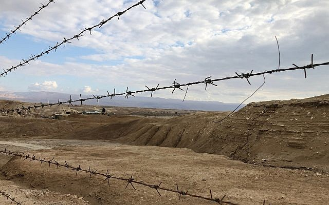 A view of the minefields outside the Qaser al-Yahud Baptism Site in the Judean Desert on the border with the Jordan River on the Eastern Orthodox holiday of Epiphany on January 18, 2019. (Amanda Borschel-Dan/Times of Israel)