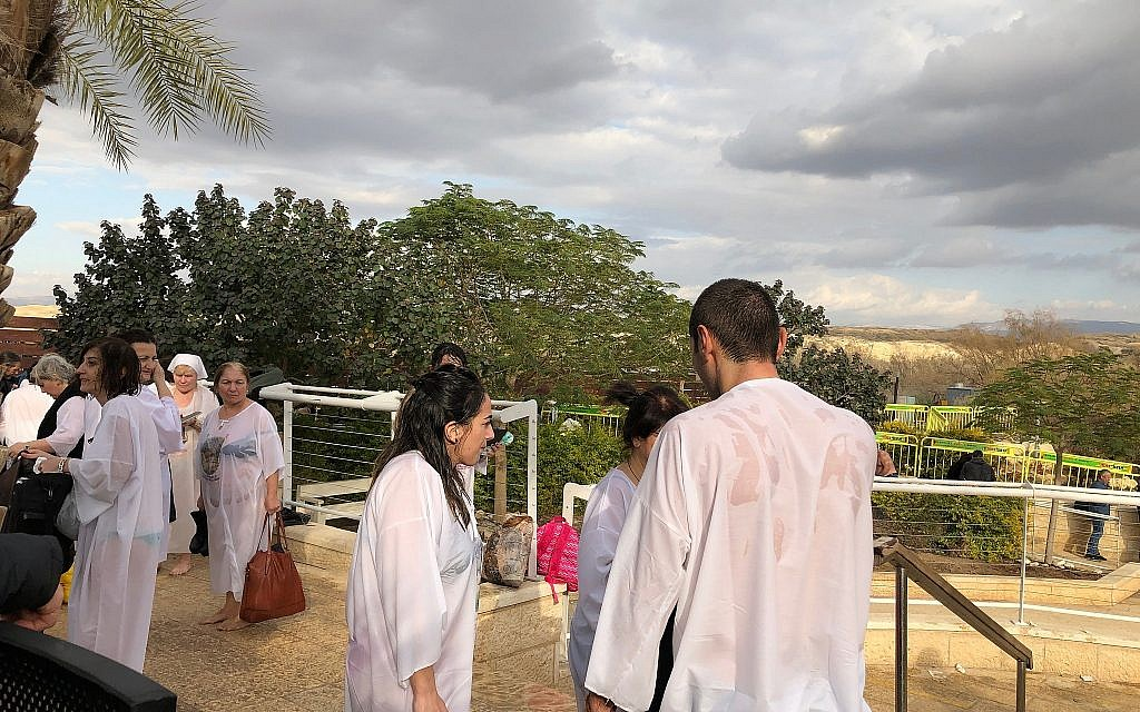 Pilgrims post-baptism at the Qaser al-Yahud Baptism Site in the Judean Desert on the border with the Jordan River on the Eastern Orthodox holiday of Epiphany on January 18, 2019. (Amanda Borschel-Dan/Times of Israel)