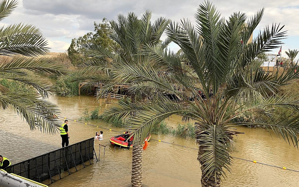 A pilgrim and her son are baptised at the Qaser al-Yahud Baptism Site in the Judean Desert on the border with the Jordan River on the Eastern Orthodox holiday of Epiphany on January 18, 2019. (Amanda Borschel-Dan/Times of Israel)