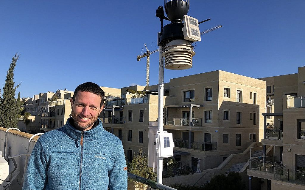 Boaz Nehemia of Yerushamayim, Jerusalem's local weather forecaster, who forecasts the weather with his home weather station on the roof of his building (Jessica Steinberg/Times of Israel)