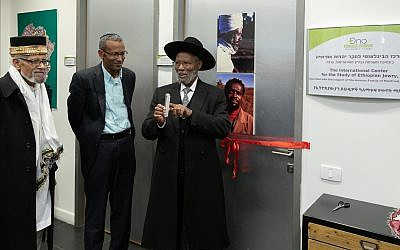 Rabbi Dr. Sharon Shalom, center, and Ethiopian religious leaders afixed the mezuzah on the door of the new International Center for the Study of Ethiopian Jewry at the Ono Academic College in Kiryat Ono on January 6, 2019. (courtesy Ono Academic College)