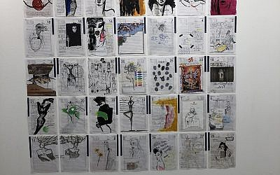 A wall of Mimi Ziv's journal pages, part of her show at the Holon Meirov Gallery (Jessica Steinberg/Times of Israel)