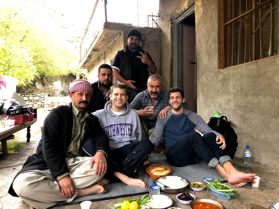 The author (R) with his brother (middle) and their Yazidi hosts in Lalish, Iraqi Kurdistan, on November 23, 2018. (Courtesy)